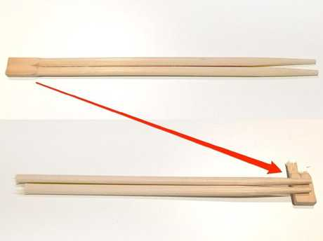 The end of the chopsticks should be snapped off to create a dainty 'rest' so you can place them on the table between courses.