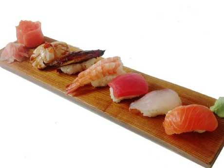 You should be placing the nigiri in your mouth fish side down, so the flavour of the fish hits the tongue.