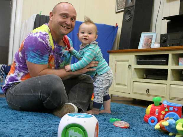 FATHER AND SON: Ben Pepper says he's happy to have extra time to play with nine-month-old Charlie as a work-from-home dad.