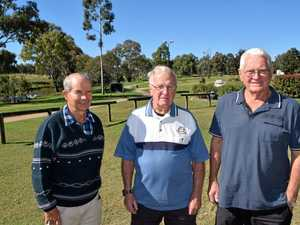 Eddie Kemp, Roger Martin and Bob Reid from the Warwick Fishstocking Association stand on the spot where they hope to install their Murray Cod sculpture.