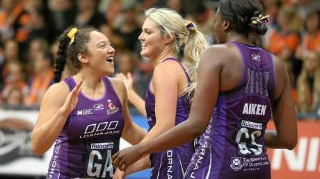 (From left) Abigail Latu-Meafou, Gretel Tippett and Romelda Aiken of the Firebirds celebrate their win.