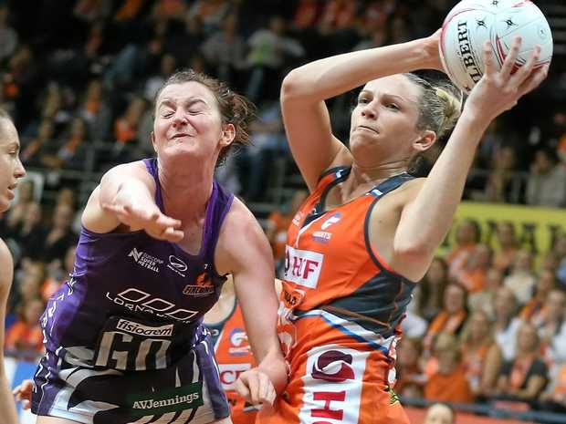 Jo Harten of the Giants and Kate Shimmin of the Firebirds compete for the ball.