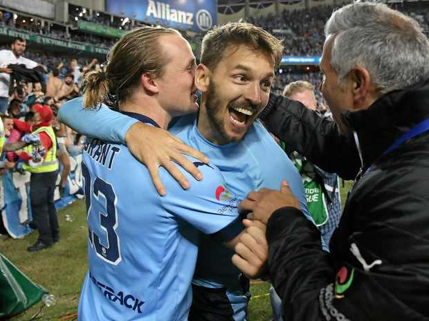 Sydney FC's Rhyan Grant and Milos Ninkovic celebrate after winning the A-League grand final.