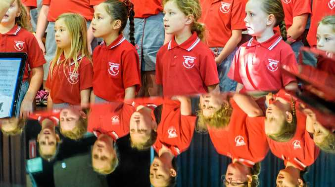 Iluka Public School choir singers are reflected on Schools day at the Lower Clarence Music Eisteddfod.