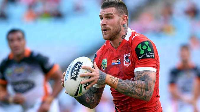 Josh Dugan of the Dragons runs with the ball.