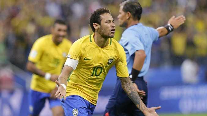 Neymar celebrates scoring for Brazil.