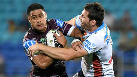Matthew Wright of the Sea Eagles (left) is tackled by Anthony Don of the Titans.