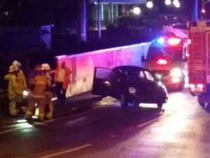 Woman hit by car, thrown onto train tracks