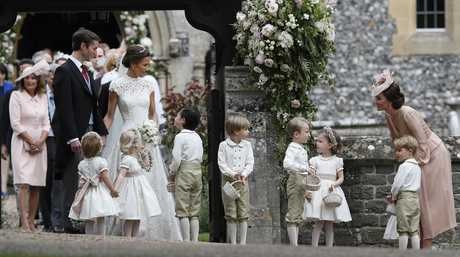 ate, Duchess of Cambridge, right, stands with her son Prince George as she looks across at Pippa Middleton and James Matthews after their wedding.