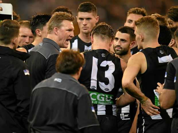 EMOTIONAL WIN: Magpies coach Nathan Buckley yells at his players during the match against Hawthorn.