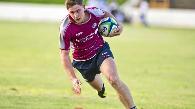 Rob Taylor of Bears on his way to score a try against USQ Saints earlier this season in the Risdon Cup.