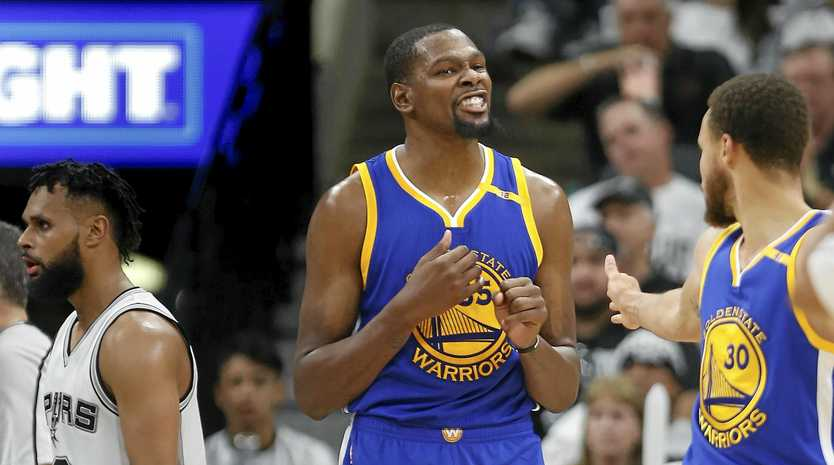 TOO STRONG: Golden State Warriors Kevin Durant (centre) and guard Stephen Curry