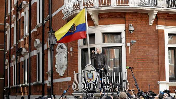 WikiLeaks founder Julian Assange gestures on the balcony of the Ecuadorian embassy prior to speaking, in London, Friday May 19, 2017. Assange has won his battle against extradition to Sweden, which wanted to question him about a rape allegation. He has spent nearly five years inside the Embassy of Ecuador in London to avoid being sent to Sweden, which announced Friday that the investigation has been discontinued. (AP Photo/Matt Dunham)
