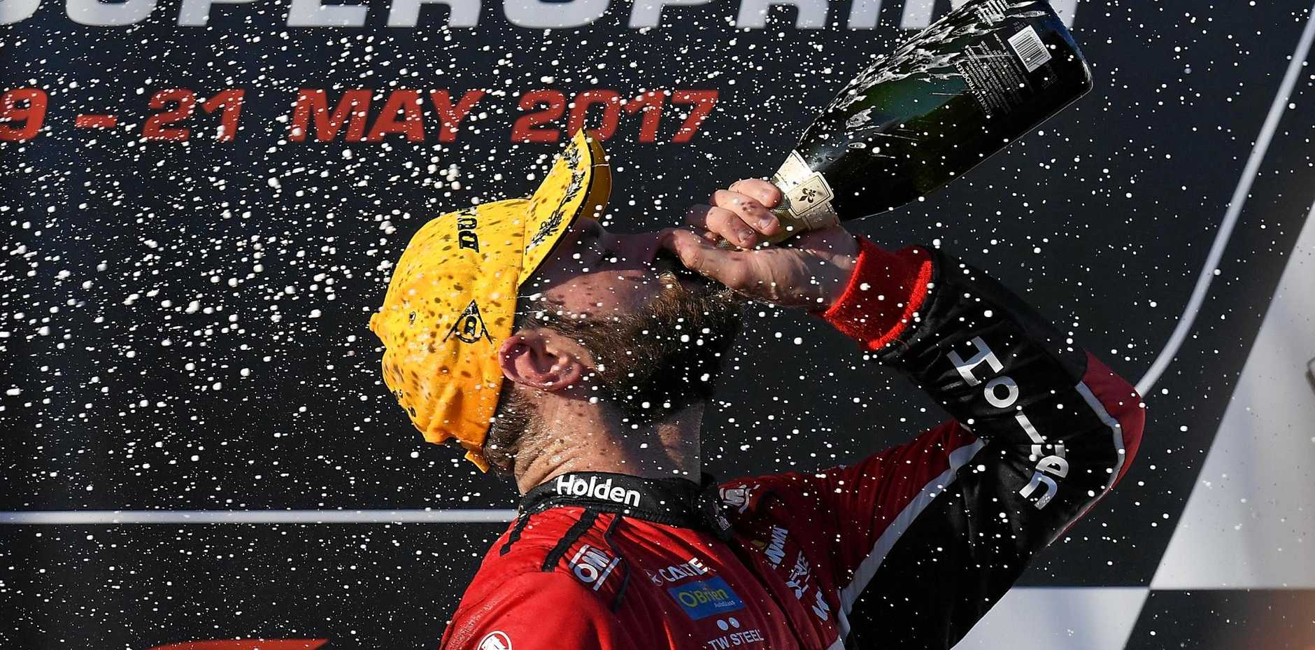 Shane Van Gisbergen celebrates after winning race 10  at Winton