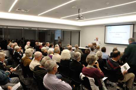 Mark Tranter talks to about 60 Toowoomba residents about the possibility of introducing community renewables.