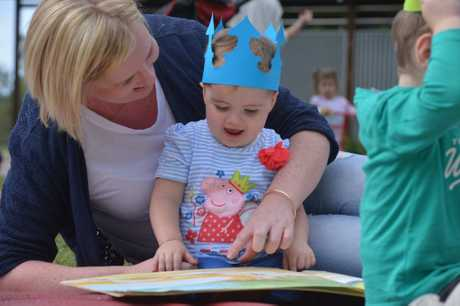 Rachelle Oliver reads with her daughter Millie Oliver at Cotton Tree park for the National simultaneous storytime. Photo: John McCutcheon / Sunshine Coast Daily