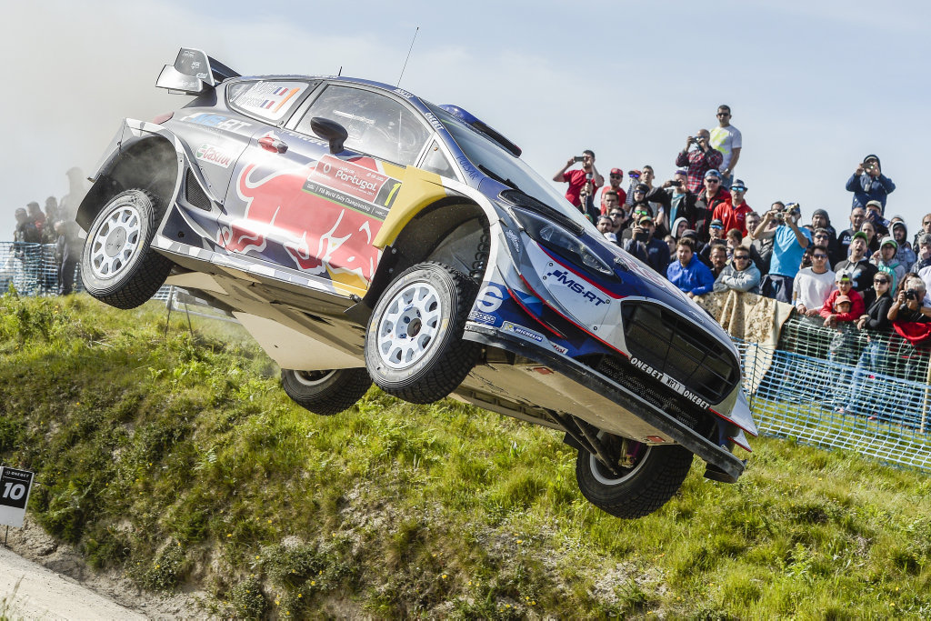 Four-time world champion Sébastien Ogier high-flies his Ford Fiesta off the famous Fafe special stage jump on the way to victory at Vodafone Rally de Portugal.