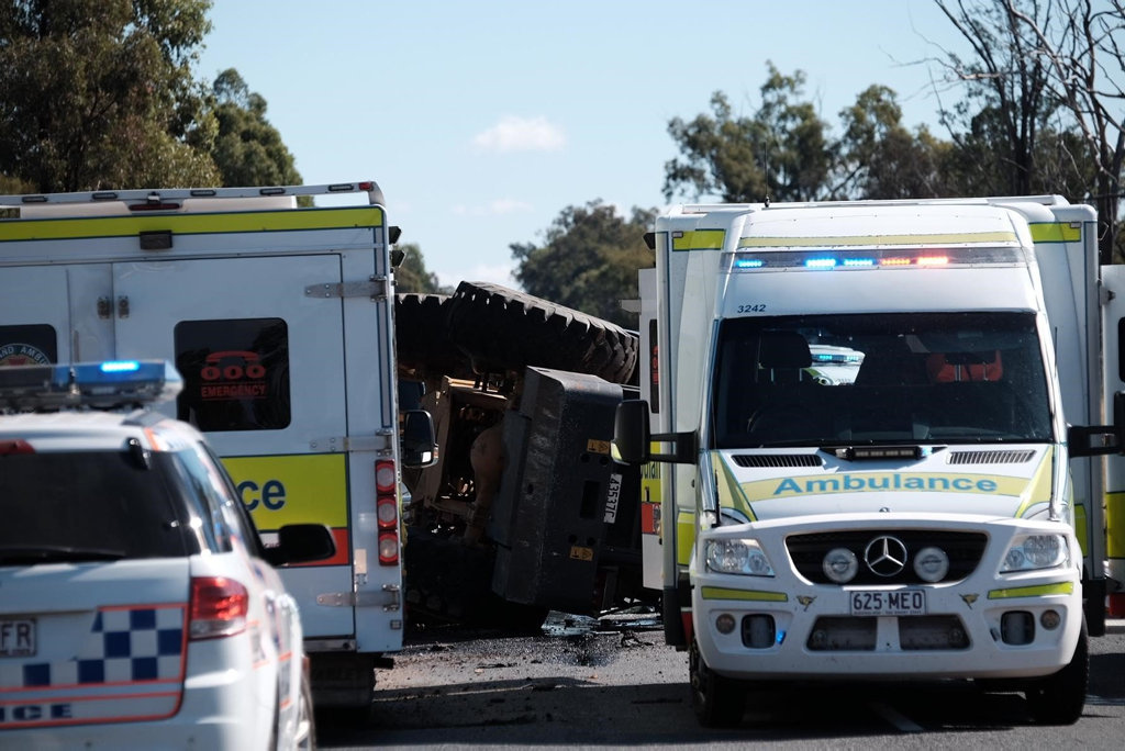 Emergency services on scene of an incident on the Warrego Hwy where a man was crushed by a tractor near Chinchilla.