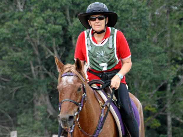 Gwen Bartolo riding to the finish line in the 120km at the Australian Endurance Riders Association event at Stirling's Crossing Equestrian Complex, Imbil.