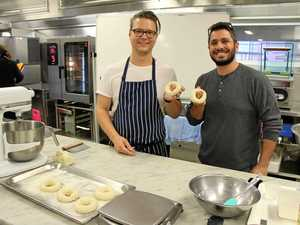 BEAUTIFUL BAGELS: Students roll pastry with Jason Janetzki, of Bright Side Bagels.