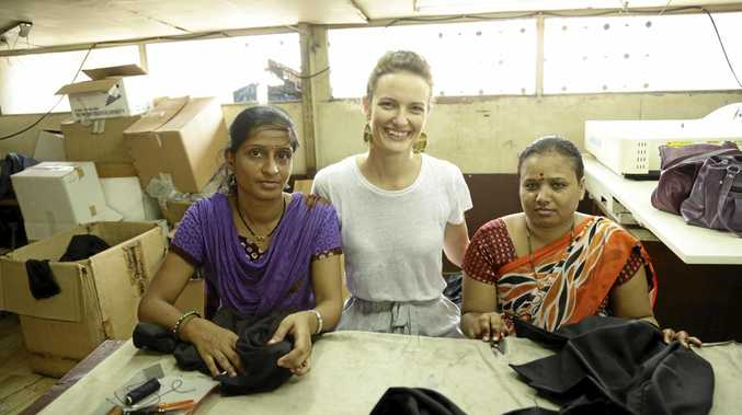 MAKING GARMENTS: Ashleigh White with two of her new employees who will help bring her vision to life.