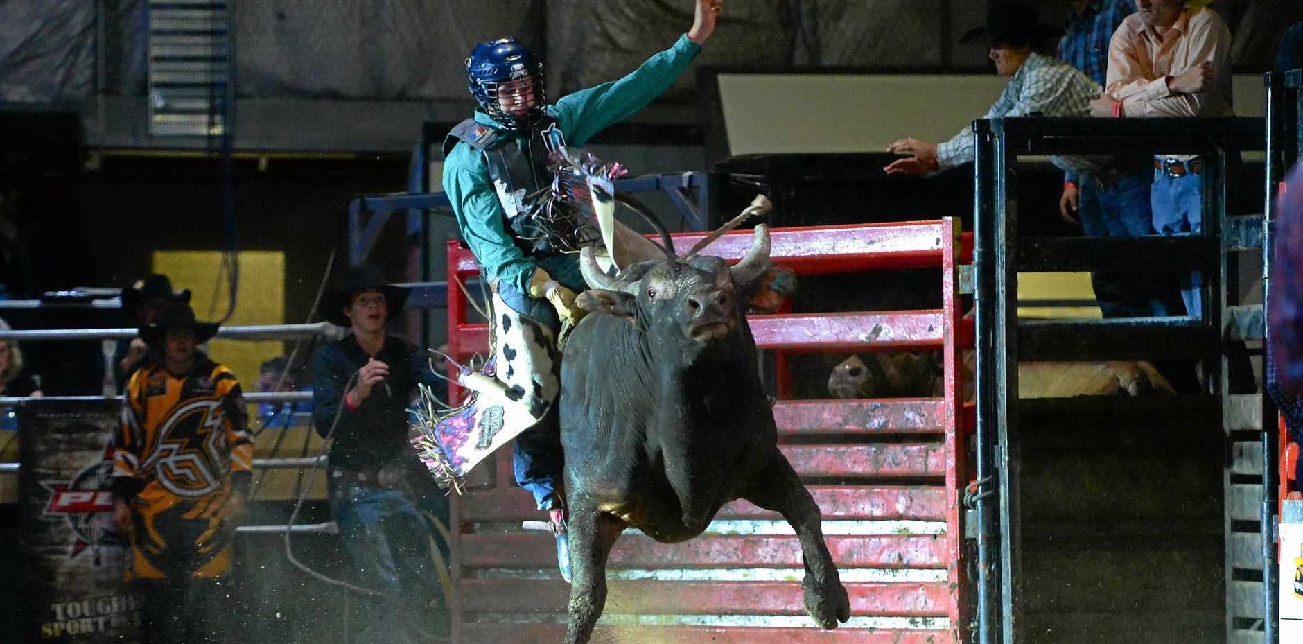 RIDE 'EM, COWBOY: Lane Mellers takes off on Mudslide at the Great Western Hotel PBR Challenge on Saturday night.