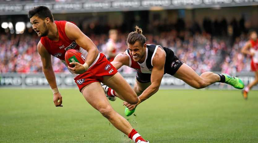 GETTING BETTER: Nic Newman gets a way from a flying Mav Weller on Saturday.