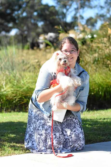 Tara Ligt and Daisy have a cuddle at the end of RSPCA Million Paws Walk on Sunday.
