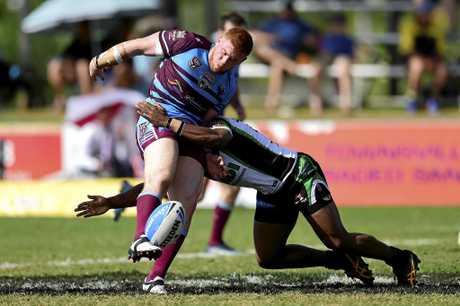 Townsville Blackhawks vs CQ Capras at Jack Manski Oval in Townsville. Blackhawks Kierran Mosley and Capras Krys Freeman. Picture: Wesley Monts