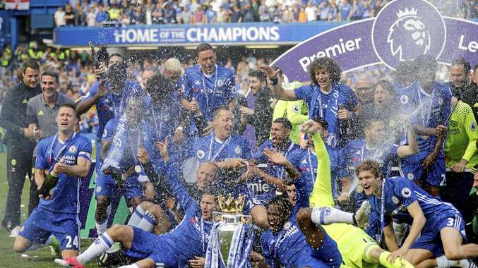 Chelsea players celebrate with the trophy after they won the EPL