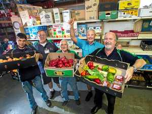 FEEDING MASSES: Loaves and Fishes' Benjamin Critten, Wayne Crowther, Ray Webb, Phil Hannaford and Russell Jones show some of the charity's food produce.