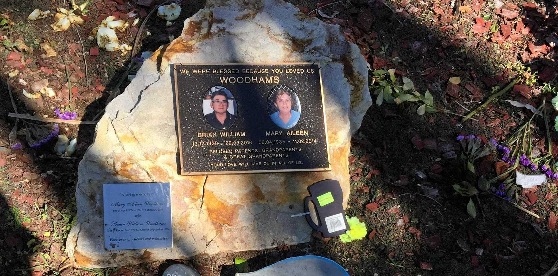 Desert roses were removed from the final resting place of Brian and Mary Woodhams.