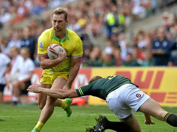 Boyd Killingworth of Australia is tackled by Dylan Sage of South Africa during the HSBC London Sevens at Twickenham Stadium.