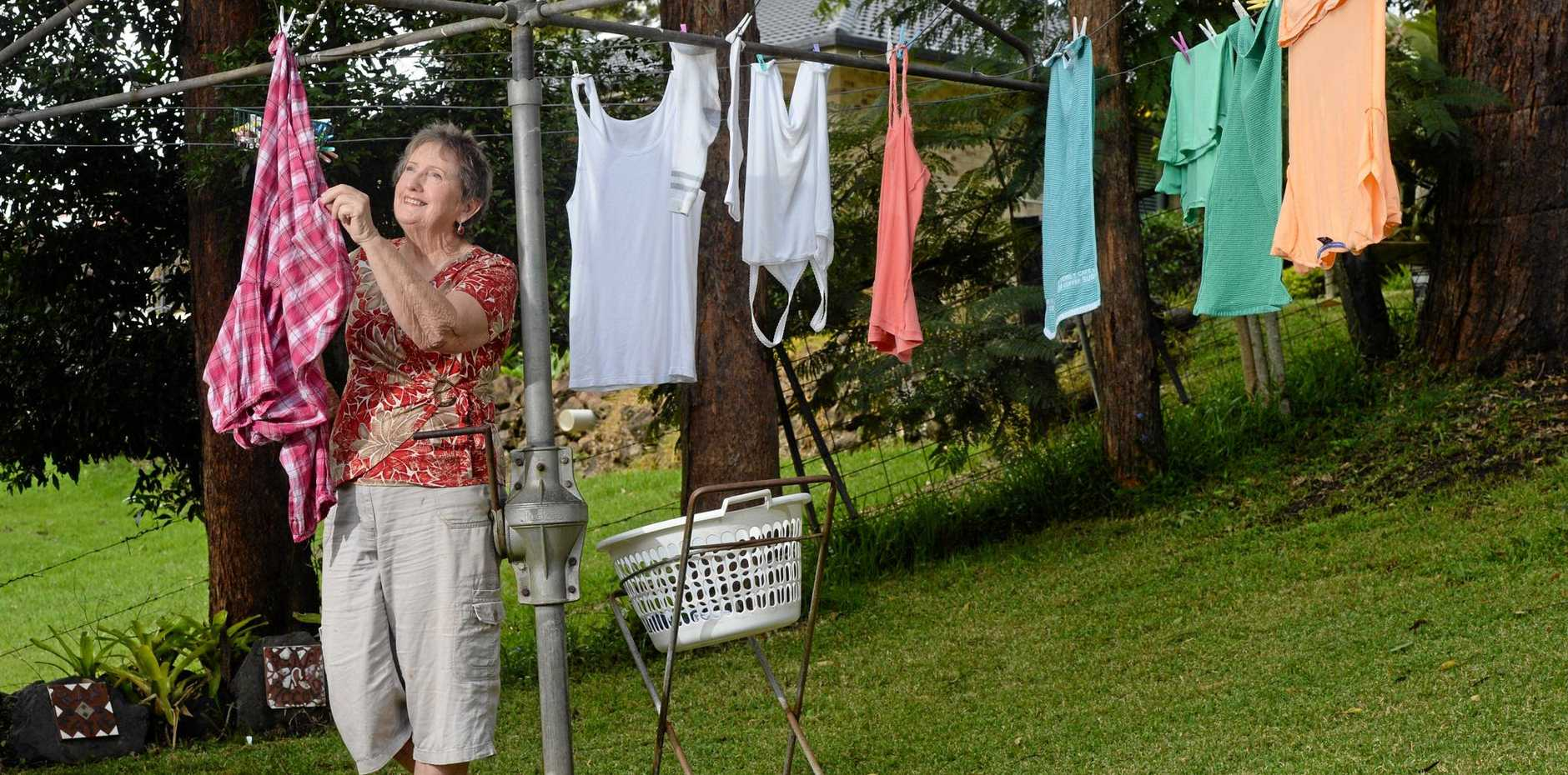 ICONIC DEVICE: Judy King, of Richmond Hill, has fond memories of the Hills Hoist in backyards across Sydney in the 1950s.