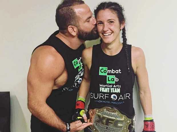 WELL DONE: Joel and Nicole Szepesvary celebrate her belt win.