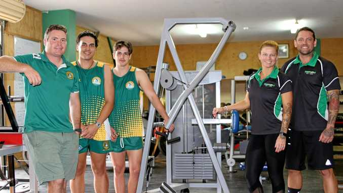 FIT AND READY: Dallas Williams and students with Mike and Nissa Ramm of Ready 24 Gym in Yeppoon who donated $30,000 worth of gym equipment to St Brendan's College.