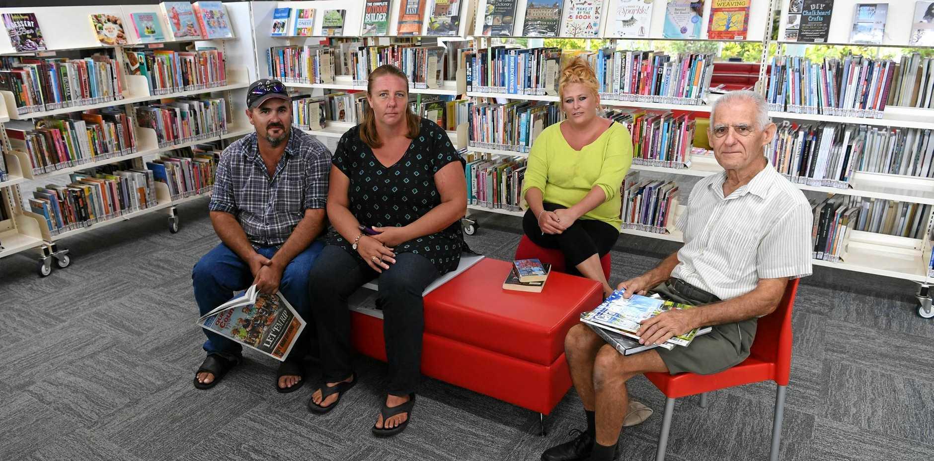 AT THE LIBRARY: Dwayne Makings, Patricia Makings, Linda Ryder and Jim Round.