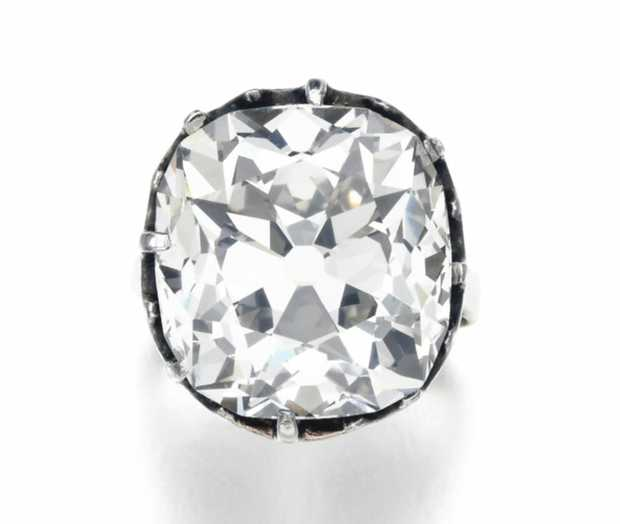 This ring was originally purchased in the 1980s from a car boot sale under the assumption that it was a decorative costume jewel. Much to the owner's surprise, the ring turned out to be a genuine cushion-shaped diamond weighing 26.27 carats.