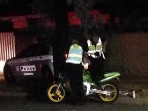 Police car runs over teenage motorcyclist