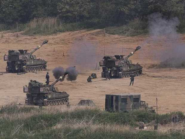 In this Monday, May 22, 2017 photo, South Korean army's K-55 self-propelled howitzers fire during the annual exercise in Paju, near the border with North Korea, South Korea. South Korea's military said Tuesday, May 23, 2017, it fired warning shots at an unidentified object flying south from rival North Korea.