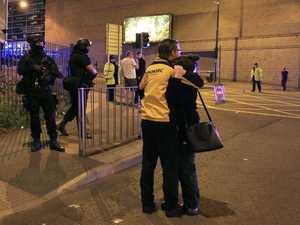 Armed police stand guard at Manchester Arena after reports of an explosion at the venue during an Ariana Grande gig in Manchester, England Monday, May 22, 2017.
