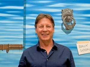 POLLIE ART: Noosa Mayor Tony Wellington with one of his double-take paintings.