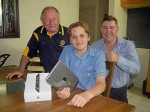 Rotary brings a smile to face of boy who lost it all