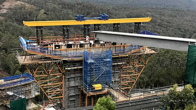 The first Super T girder launched and placed in the viaduct on the Toowoomba Second Range Crossing.