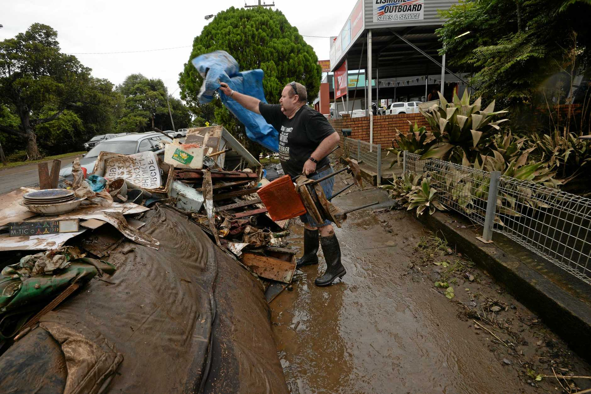 Brett Grainger, of South Lismore, helps to clean up town.