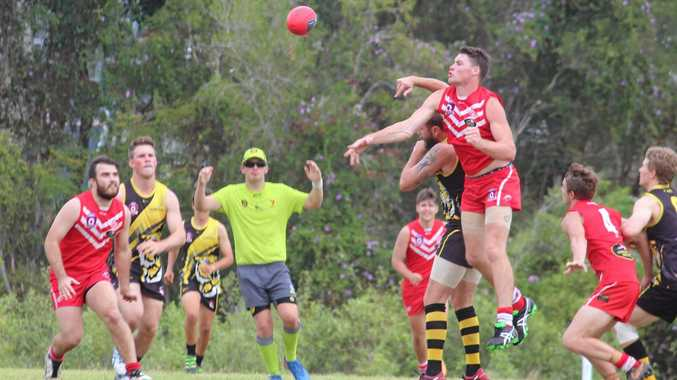 Yeppoon Swans Eli Wells wins the ruck contest with on ballers Harry Boyd and Blair Pearce ready to pounce.