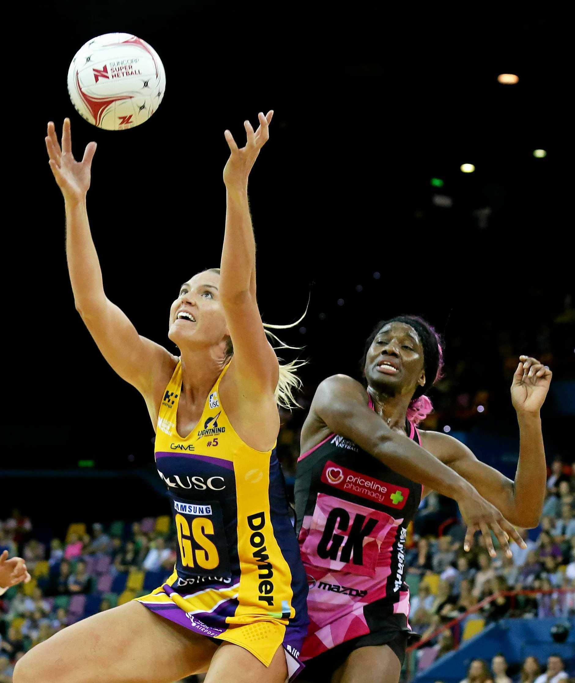STAR SHOOTER: Caitlin Bassett reaches for the ball.