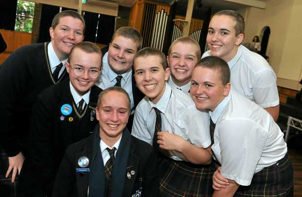 NEW DO: Showing off their freshly shaved heads for a good cause are (from left) Fairholme College students Abby Love, Lola Lachmund, Jade Bahnisch, Arabella Gourley, Lily Pagalis-Jackson, Emily Munro, Emma Baker and Ashleigh Bradfield.
