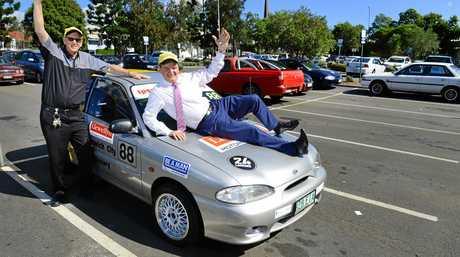 Keith Lewis of Queensland Raceway and Mayor Paul Pisasale celebrate the upcoming 24 Hours of LeMons at Queensland Raceway.