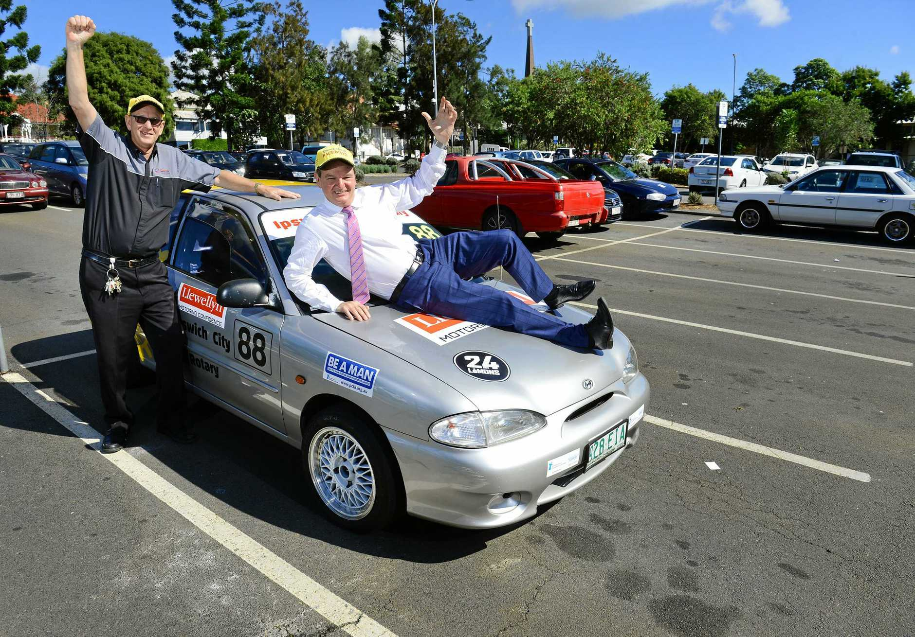Keith Lewis of Queensland Raceway and Mayor Paul Pisasale celebrate the upcoming 24 Hours of LeMons at Queensland Raceway.